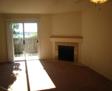 1425 serrano end townhome living room area and gas fireplace