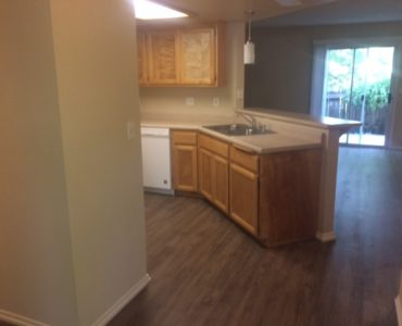 picture of willow park remodeled end townhome kitchen and living room with laminate flooring