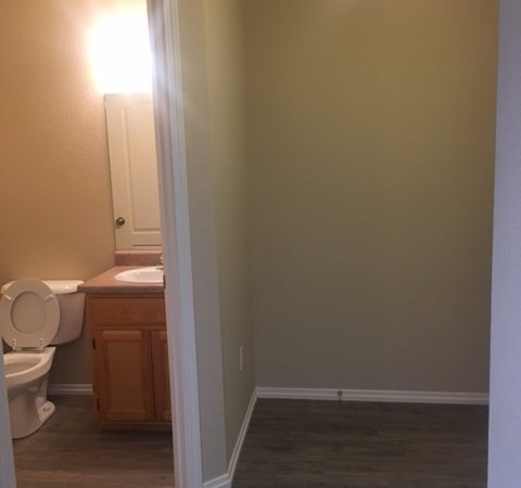 picture of willow park remodeled middle townhome half bath and entry way with laminate flooring