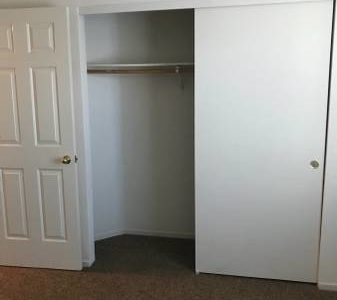 photo of windsor court duplex bedroom closet